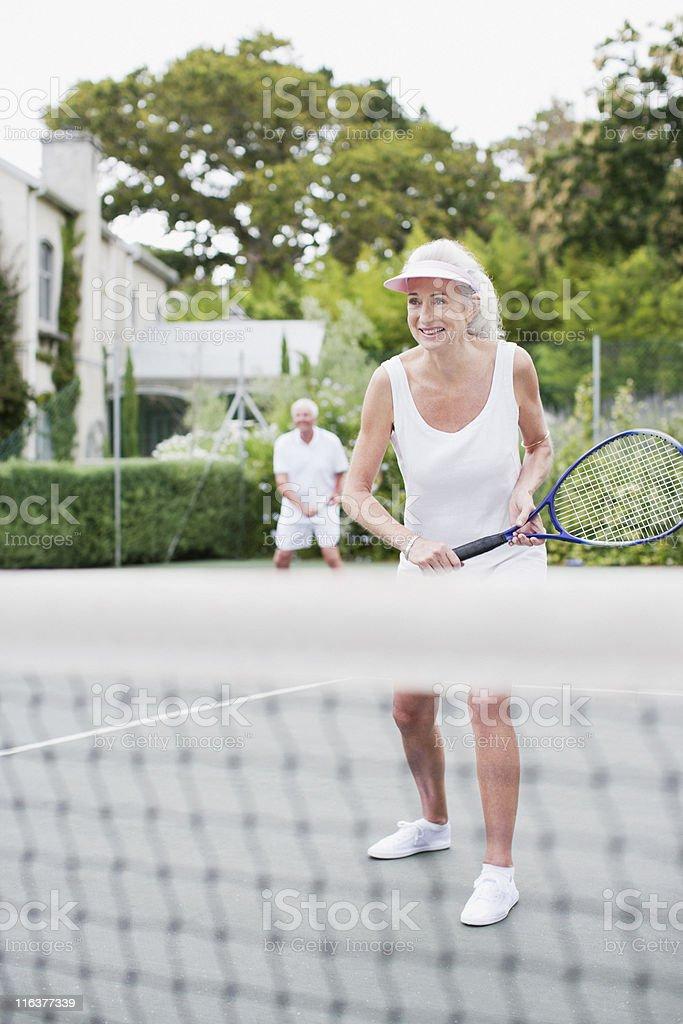 Senior couple playing tennis royalty-free stock photo