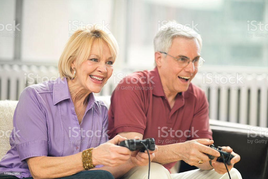 Senior Couple Playing Video Games royalty-free stock photo