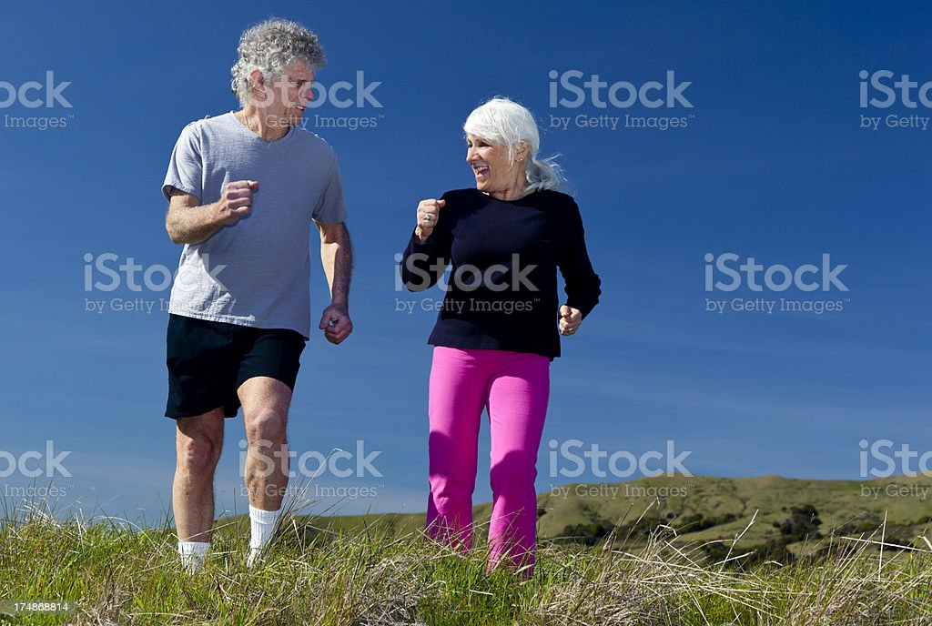 senior couple power walking royalty-free stock photo