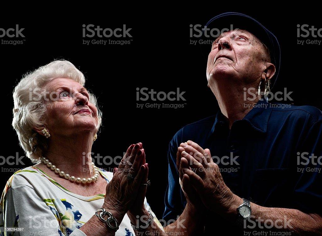 Senior Couple Praying Together royalty-free stock photo