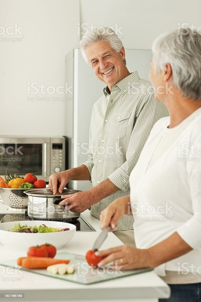 Senior couple preparing lunch at home royalty-free stock photo