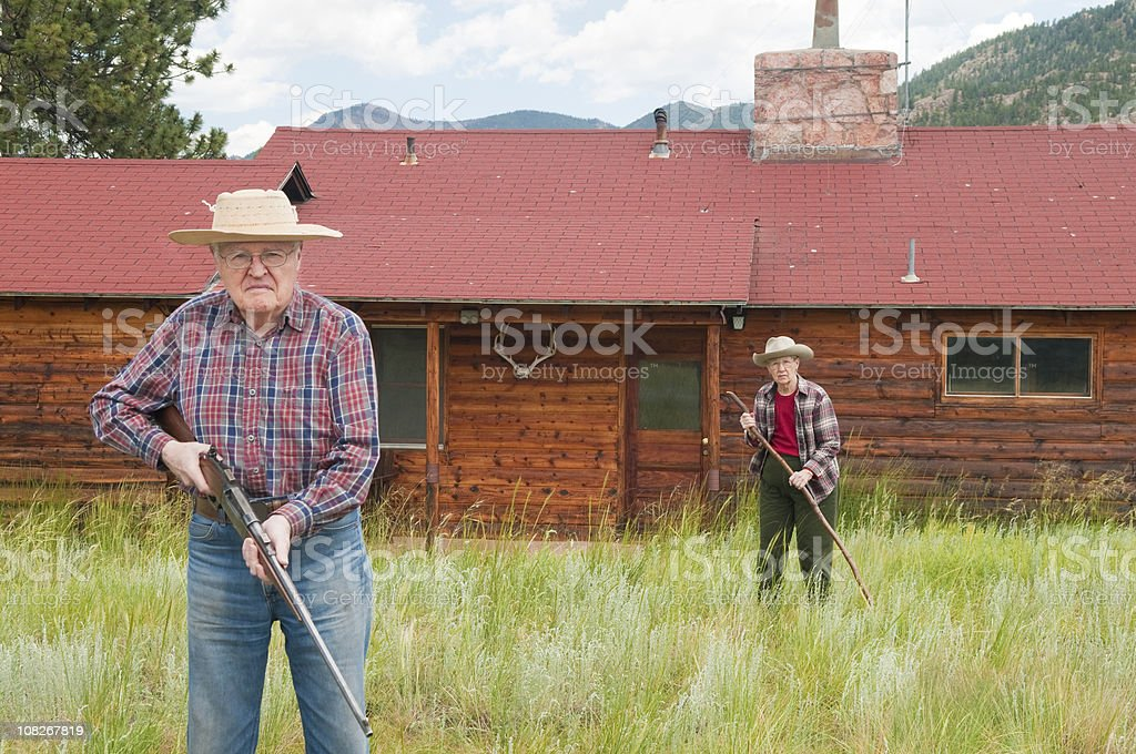 Senior Couple Protecting Homestead royalty-free stock photo