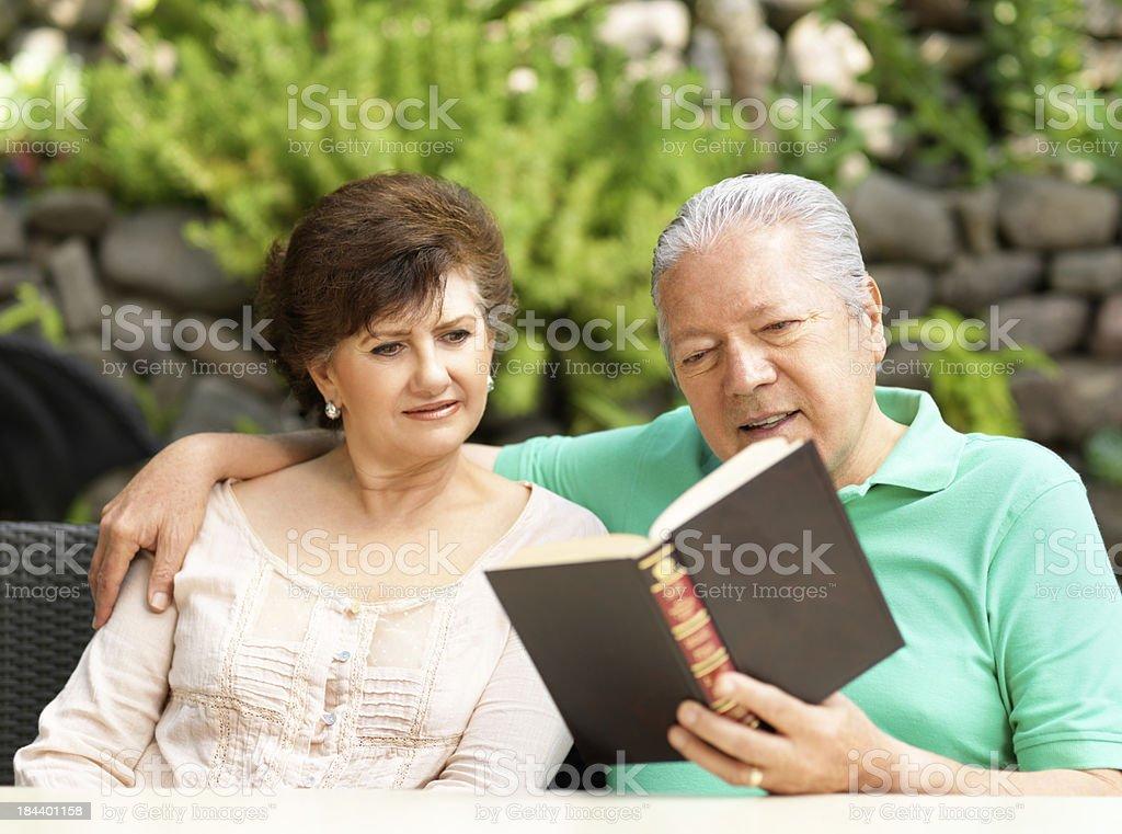 Senior couple reading a book royalty-free stock photo
