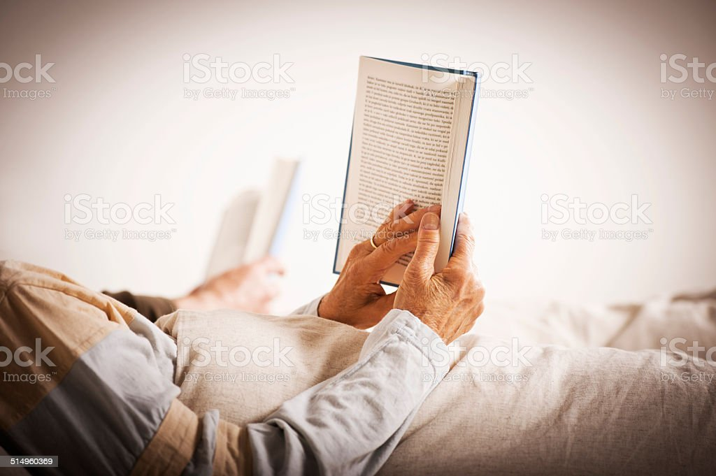 Senior couple reading a book stock photo