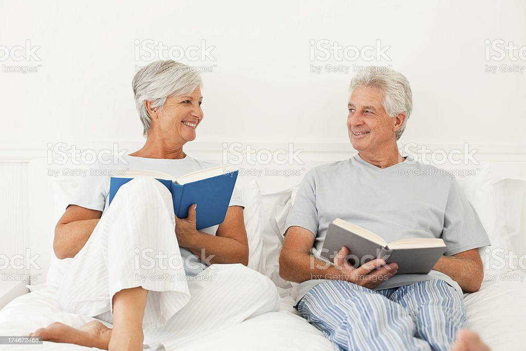Senior couple reading book stock photo