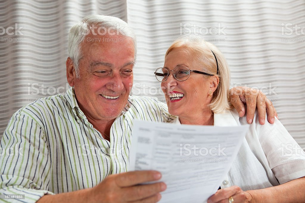 Senior Couple reading documents royalty-free stock photo
