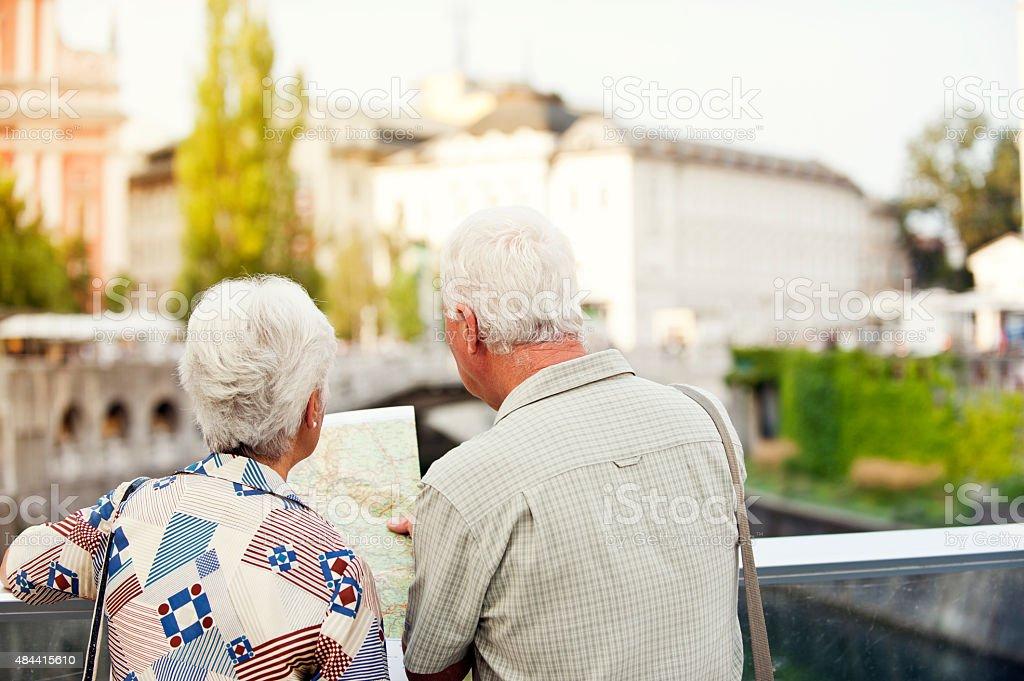 Senior couple reading map stock photo