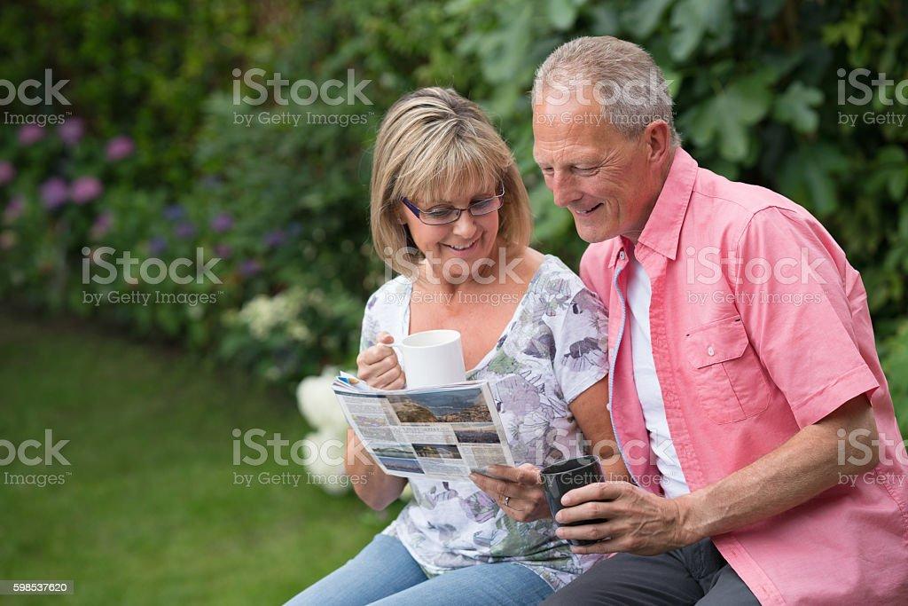 Senior couple reading the newspaper stock photo
