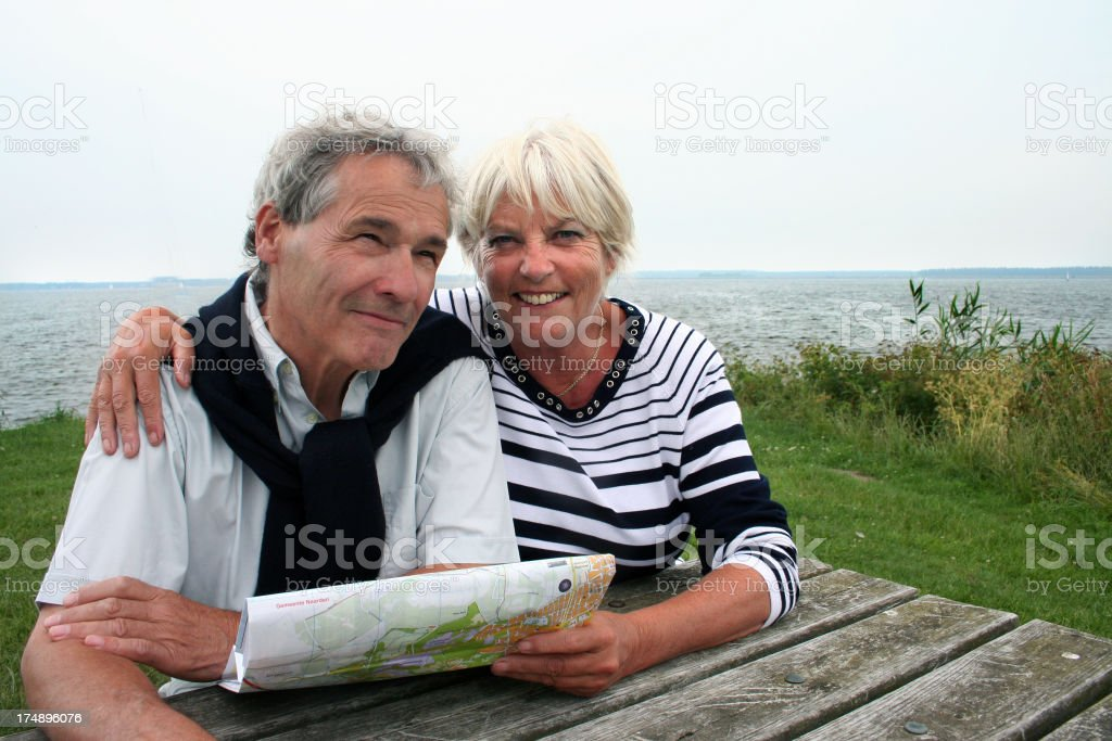 Senior couple reads a map royalty-free stock photo