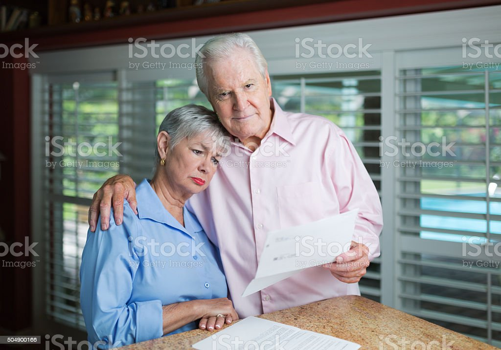 Senior couple receiving bad news stock photo