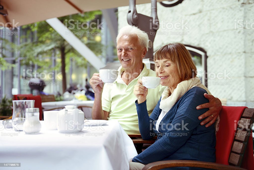 Senior couple relaxing at cafe royalty-free stock photo