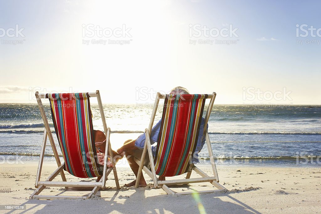 Senior couple relaxing at the beach royalty-free stock photo