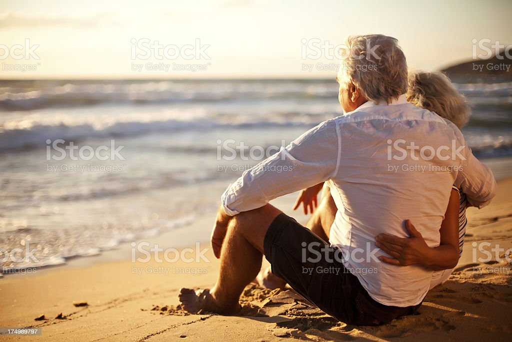 Senior couple relaxing by the sea royalty-free stock photo