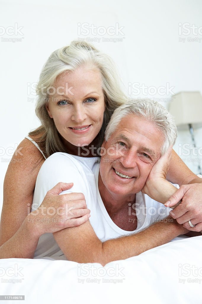 Senior Couple relaxing In Bed stock photo