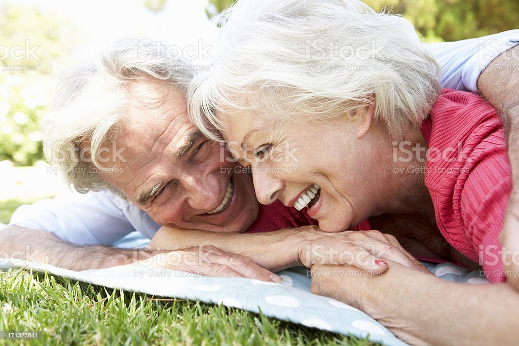 Senior Couple Relaxing In Park Together royalty-free stock photo