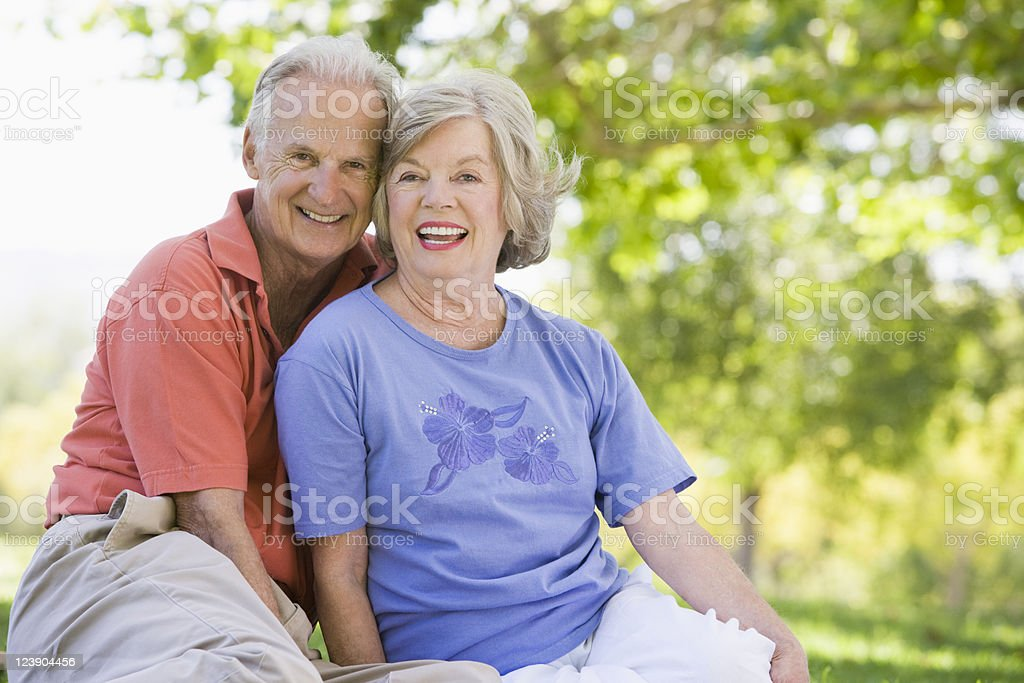 A senior couple relaxing in the park royalty-free stock photo