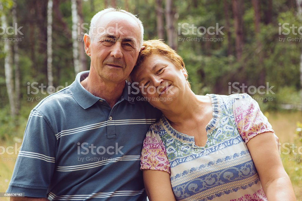 Senior couple relaxing in woods stock photo