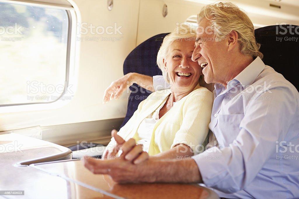 Senior Couple Relaxing On Train Journey stock photo