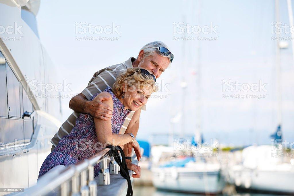Senior couple relaxing on yacht stock photo