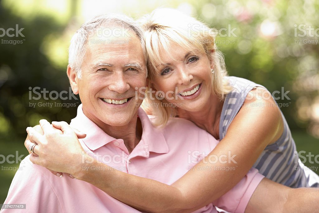 Senior couple relaxing together in park royalty-free stock photo