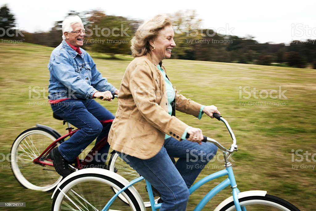 Senior Couple Riding Bicycles stock photo