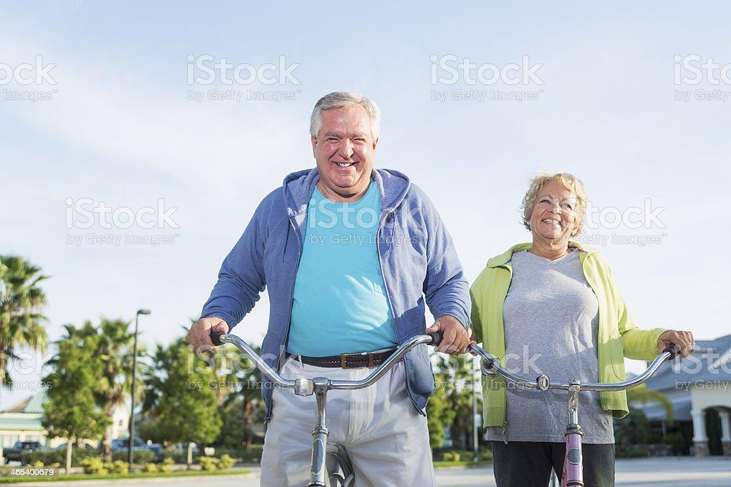 Senior couple riding bicycles royalty-free stock photo
