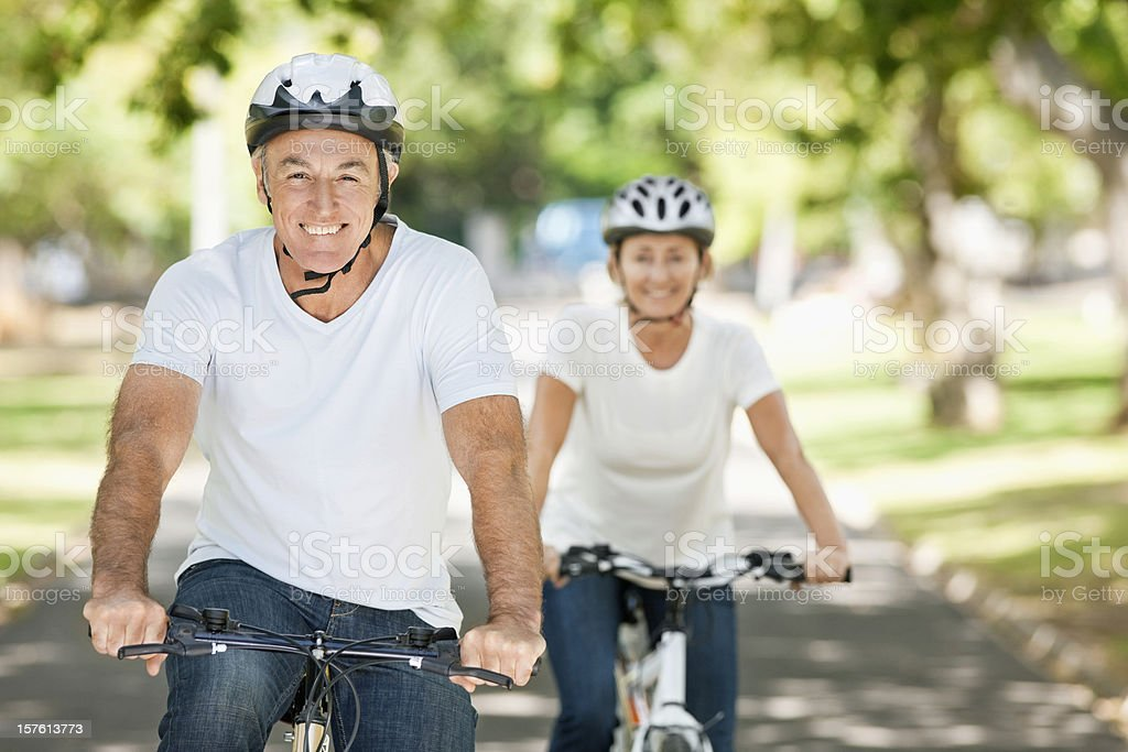 Senior Couple Riding Bikes royalty-free stock photo