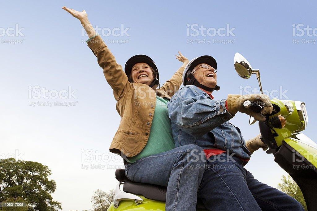 Senior Couple Riding Scooter stock photo
