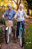 Senior couple riding their bike