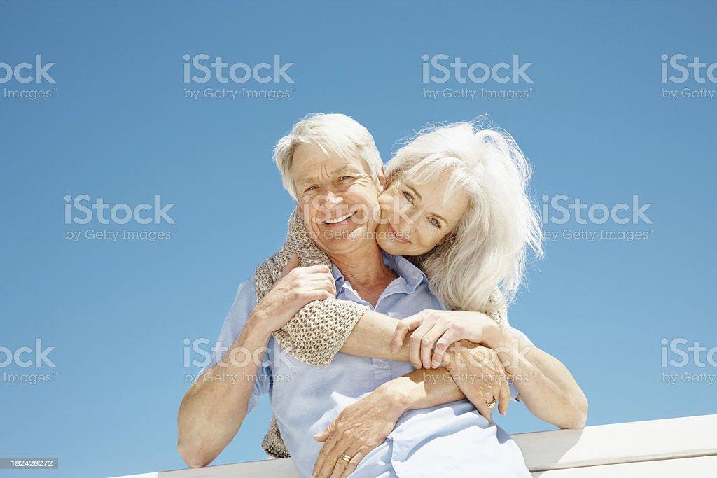 Senior couple romancing against blue sky royalty-free stock photo