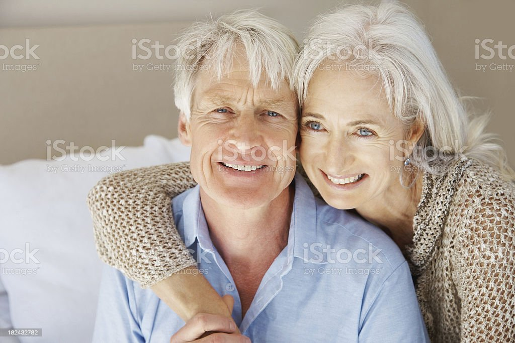 Senior couple romancing at home royalty-free stock photo