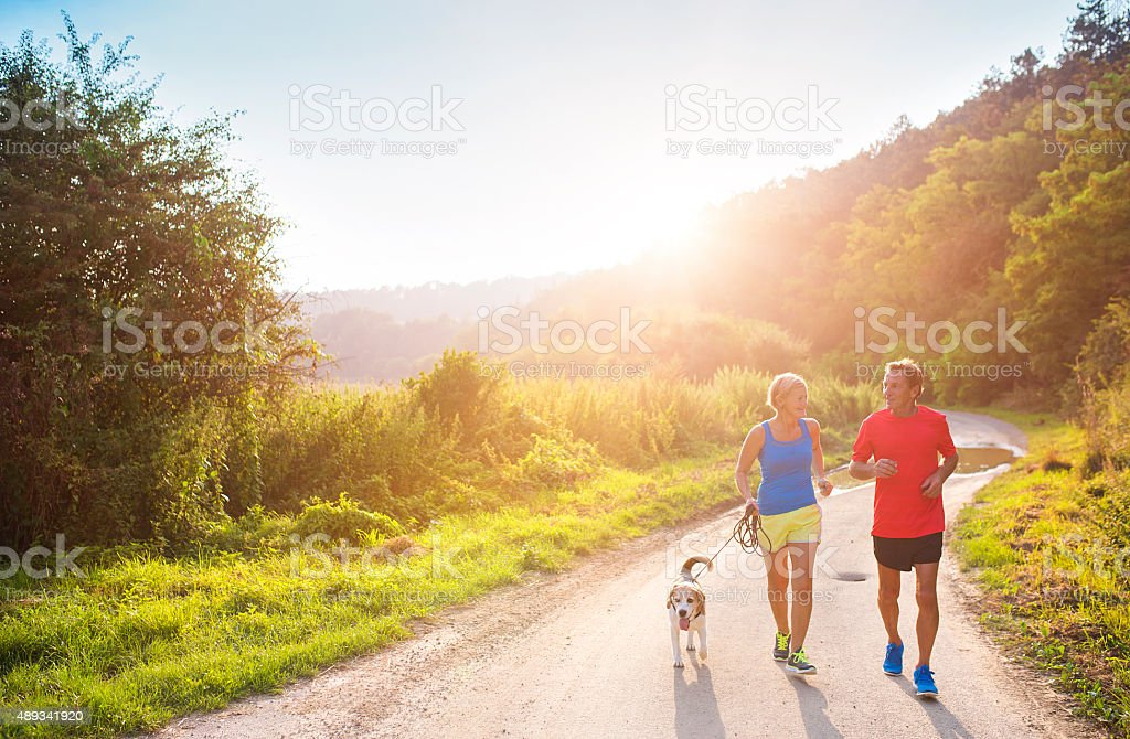 Senior couple running stock photo