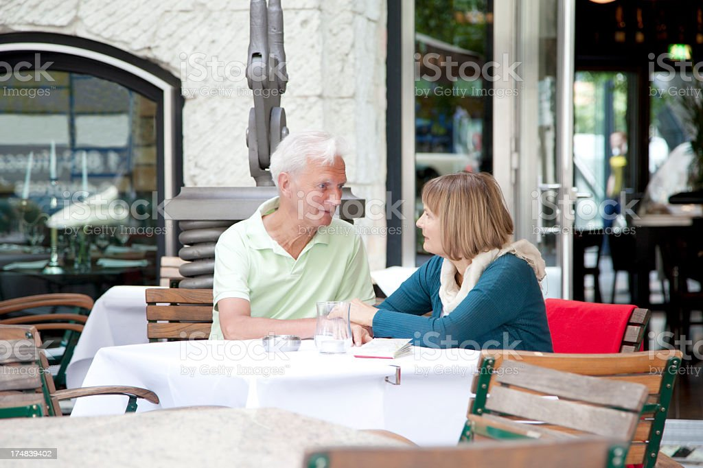 senior couple seated at coffee shop royalty-free stock photo