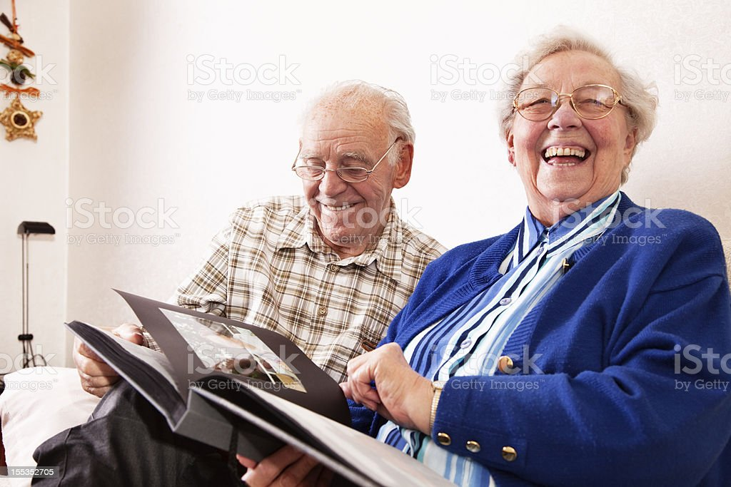 senior couple sharing happy memories at home stock photo