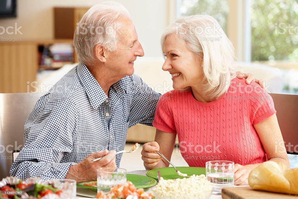 Senior couple sharing meal royalty-free stock photo
