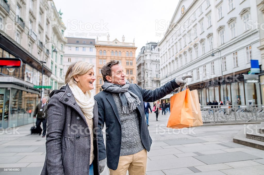 Senior couple shopping in centre of the city. Winter stock photo