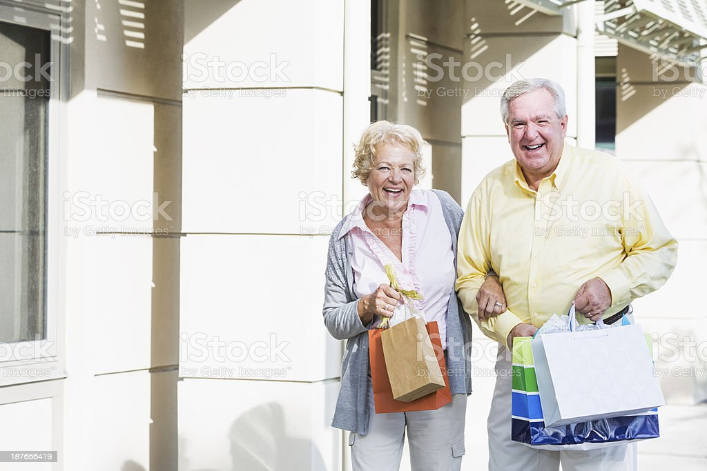 Senior couple shopping royalty-free stock photo