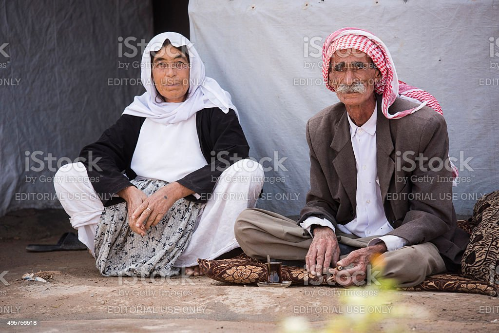 Senior couple sitting in front of their tent stock photo
