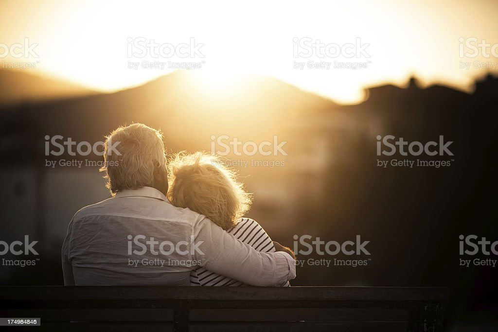 Senior couple sitting on a bench royalty-free stock photo