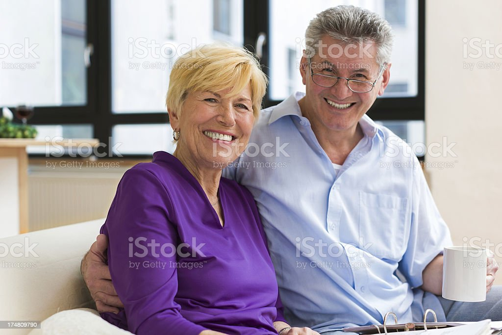 Senior couple sitting on Couch royalty-free stock photo
