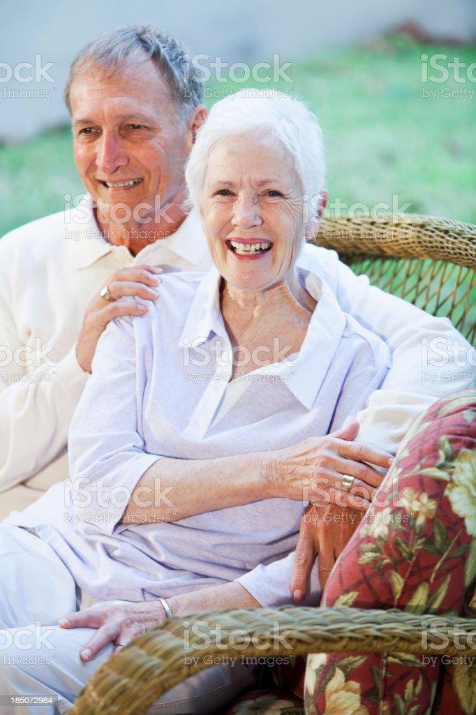 Senior couple sitting together on patio stock photo