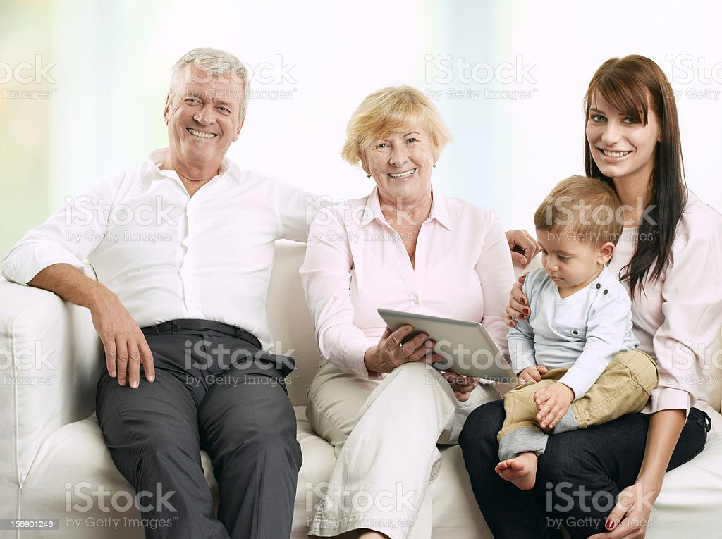 Senior couple sitting with their daughter and grandson royalty-free stock photo