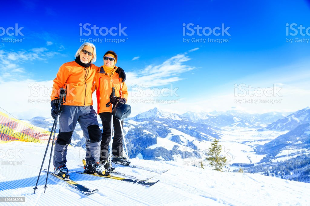 senior couple skiing royalty-free stock photo