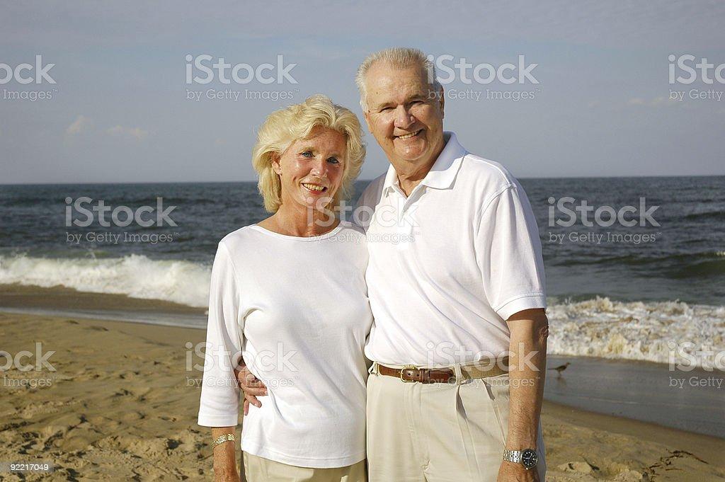 Senior Couple Smiling On The Beach royalty-free stock photo