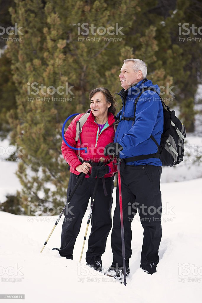 Senior Couple Snow Shoeing stock photo