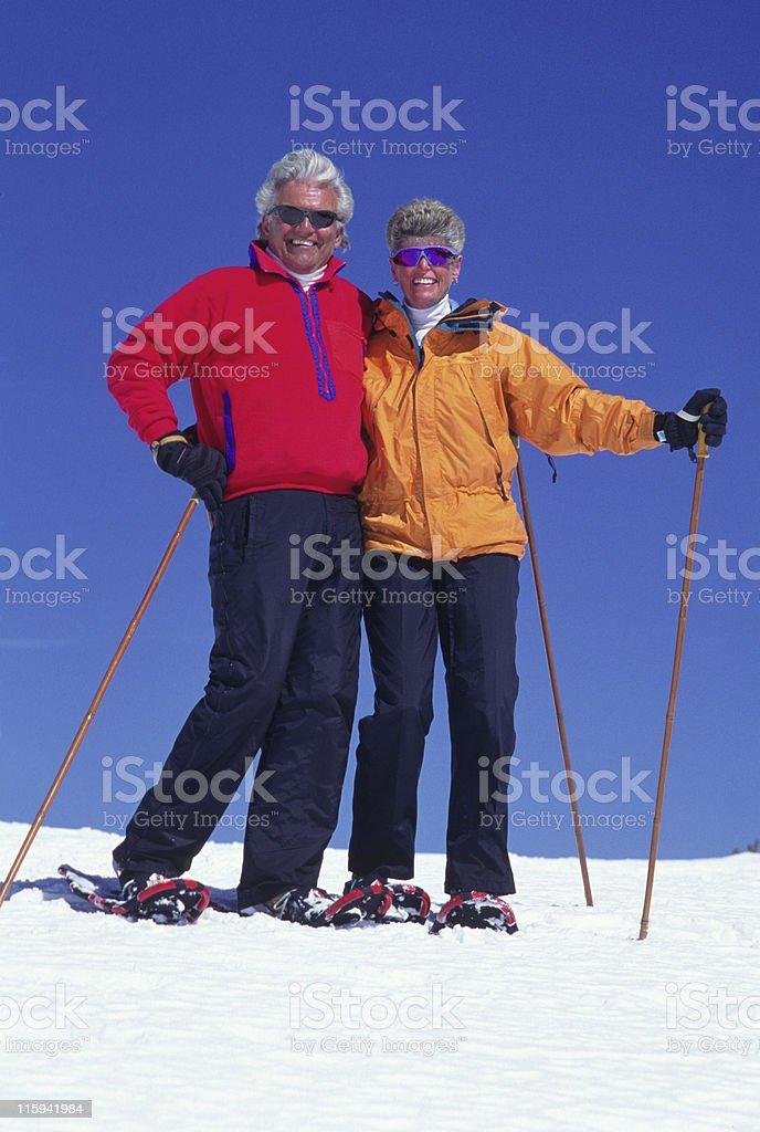Senior Couple Snowshoeing royalty-free stock photo