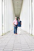 Senior couple standing in white pillar hallway