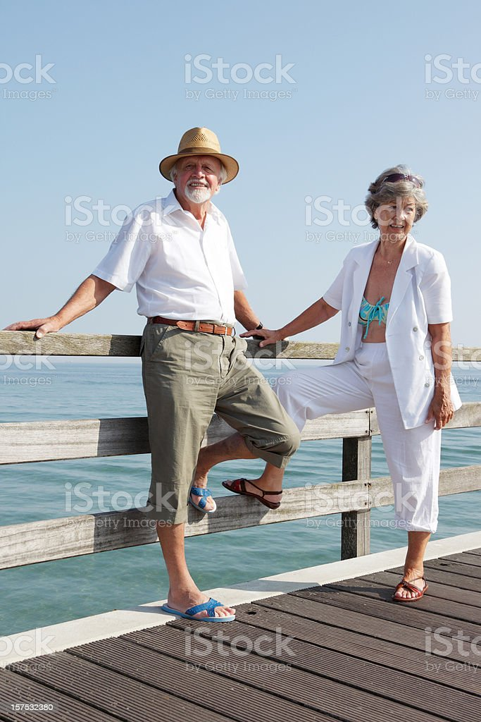 Senior Couple Standing on a Pier royalty-free stock photo