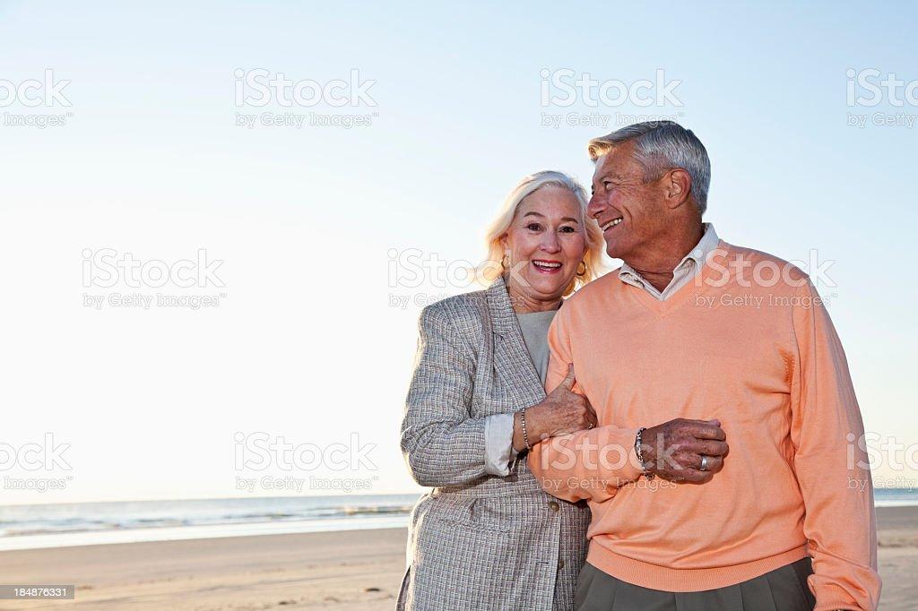 Senior couple standing on beach royalty-free stock photo