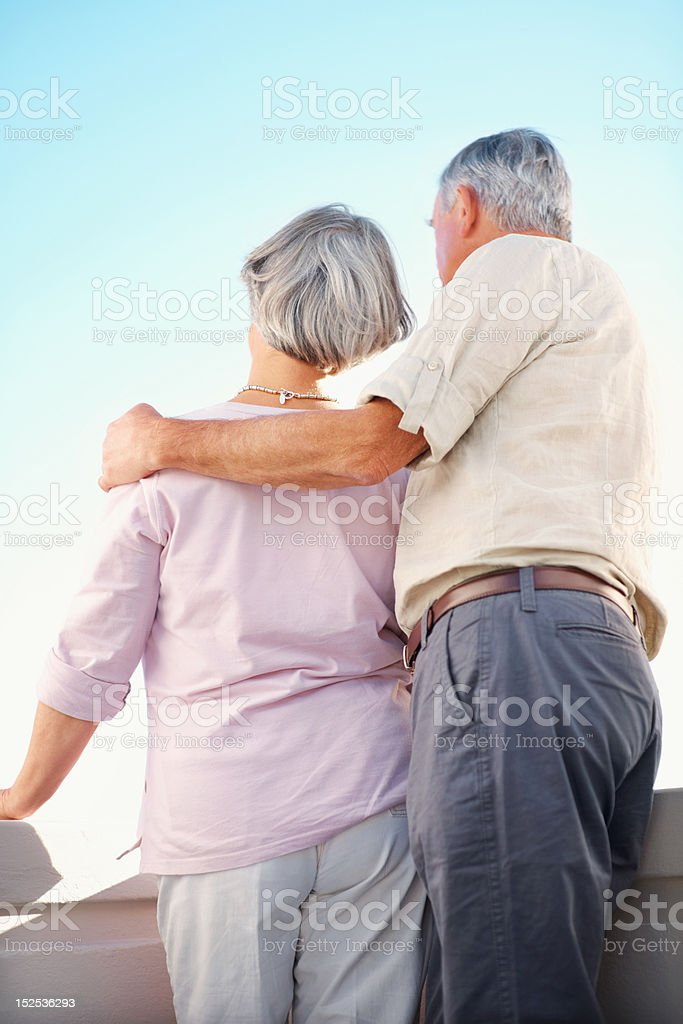 Senior couple standing together outdoors royalty-free stock photo